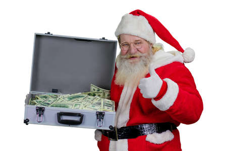 grandfather frost: Santa Claus with case of hundred dollars. Portrait of happy Santa Claus holding full suitcase of cash and giving thumb up, isolated on white background.