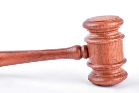 Judge gavel isolated on white background. Wooden gavel isolated over white. Stock Photo