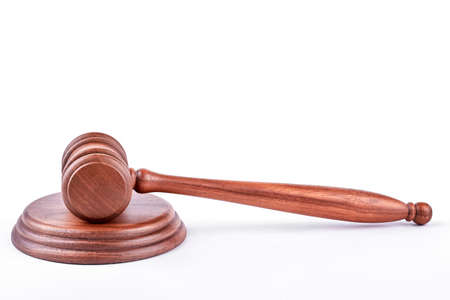Wooden gavel on wooden stand. Judge gavel and wooden stand on white background. Law, justice and auction.