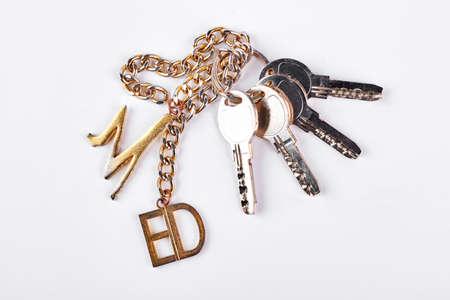 Bunch of keys on white background.