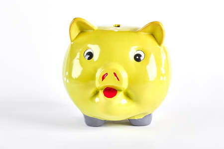 Yellow piggy bank isolated over white. Stock Photo