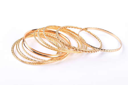 Collection of gold wrist bands isolated on white background. Stock Photo