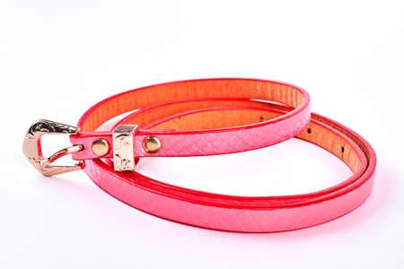 Female elegant leather belt. Red women style belt isolated on white background.