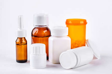 Traditional medicine to treat flu. Drugs and medical liquid in bottles for cold trreatment. Medicine, health care and pharmaceutical drugs concept. Standard-Bild