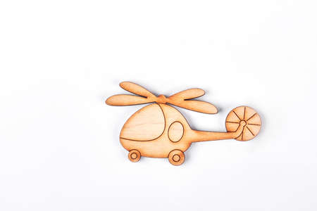 baby playing toy: Cartoon toy helicopter, white background. Carved wooden helicopter toy isolated on white background.