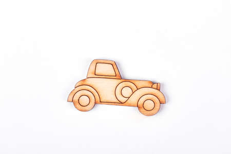 Cartoon toy automobile, white background. Cardboard cutout toy car isolated on white background. Kids healthy toys.