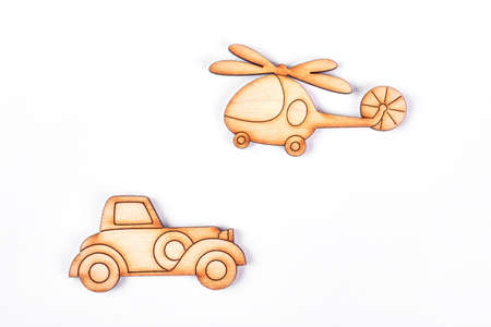 baby playing toy: Cardboard helicopter and automobile. Cartoon car and airplane on white background. Natural miniature toys for kids. Stock Photo