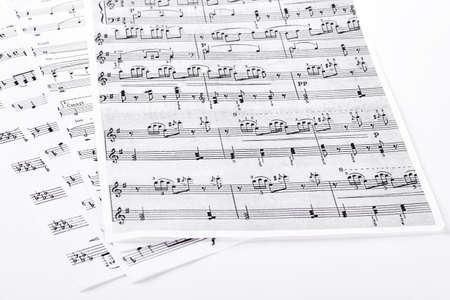 Sheets with musical notes. Pages with musical notes and keys, isolated on white background. Banque d'images
