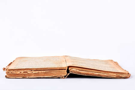 Ancient book on white background. Very old book. Aged book over white.