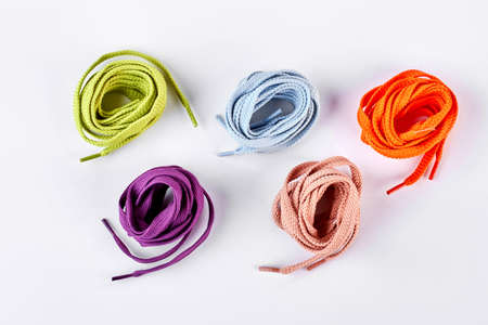 Five colorful round shoe laces. Set of multicolored shoe string rolls isolated on white background, top view.