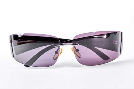 Purple square sunglasses without rim. Sunglasses with purple glass isolated on white background. Sun protection vintage accessory.