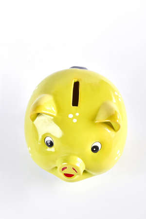 Yellow piggy bank, top view. Piggy bank isolated on white background. Container for money savings. Stock Photo