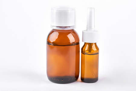 nasal: Medication to treat running nose. Two brown glass bottles with medicine for cold treatment. Cold and treatment concept. Stock Photo
