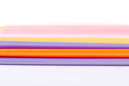 Set of colorful folders for documents. Assortment of transparent multicolored jackets for books over white background. School stationery concept. Stock Photo