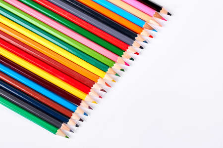 Collection of multicolored pencils for drawing. Assorted colorful pencils on white background. Creativity and art concept.