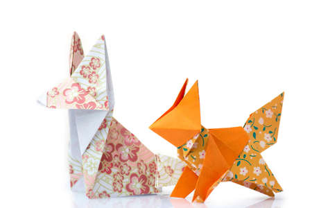 Two origami foxes. Cute designed paper figurines of animals. Folding paper with fun and creative. Stock Photo