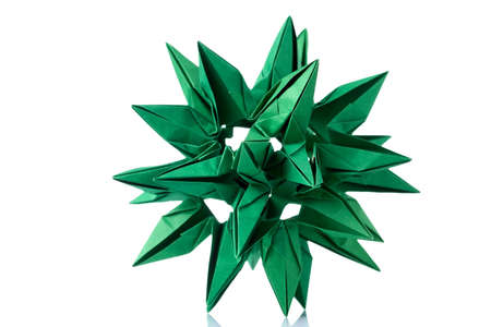 Abstract green cosmic body origami, isolated on white. Advanced level of craft project. Artwork, folding paper craft. Stock Photo