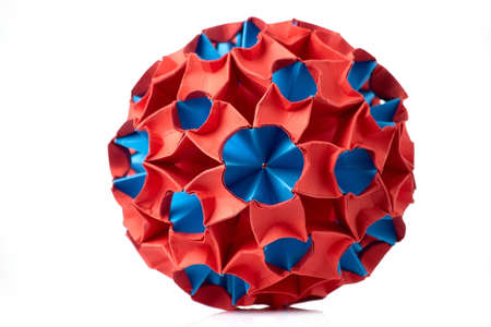 Red and blue paper art. Meteorite ornament, spherical shape, beautiful and complex origami project.