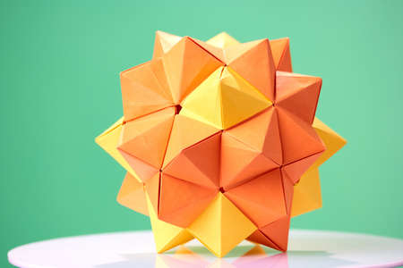 Dodecahedron origami on green background. Beautiful 3D paper model as item of exposition. Childs talent and creativity.