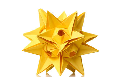 Yellow star origami figurine isolated on white background. Astronomical bodies. Fancy artwork, school project. Stock Photo
