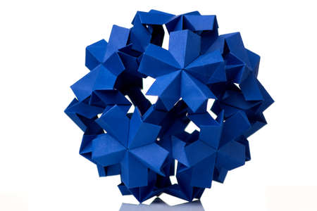 Blue flower isolated on white. Cool paper folding project. Floral origami decoration, result of arts lesson at the school.
