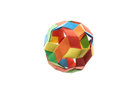 Colorful spherical origami model on white background. Multicolor kusudama ball. Difficult level of folding paper, hobby. Stock Photo
