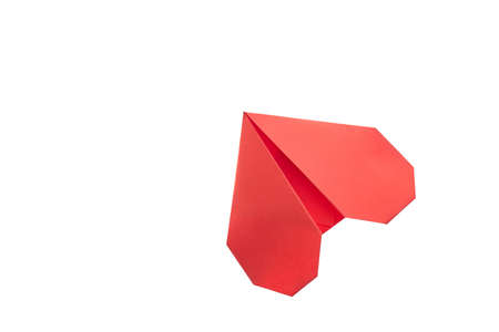 Red heart origami on white. Unusual envelope, folding paper art. Beautiful way to confess in love.