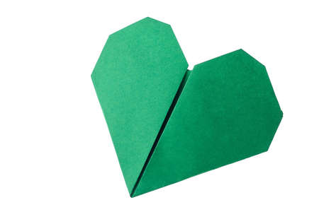 Green heart origami on white. Result of simple folding instructions. Crafting with kids ideas. Stock Photo
