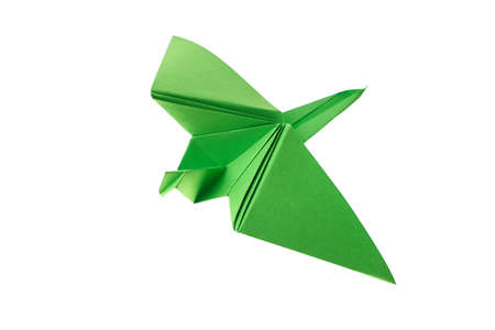 Green paper crane on white. Classic origami model. Japanese art, traditions and culture.