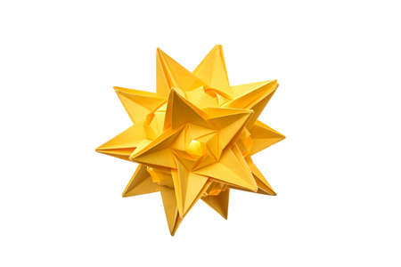 Stellated dodecahedron origami on white. Modular paper figurine made of yellow paper looks like a star.