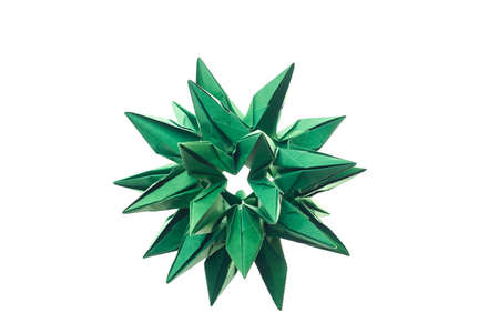 Spiky stellated modular origami art. Made of green paper, folded paper units. Cosmic body, crystal concept.