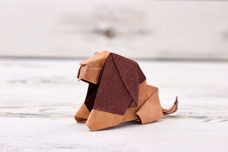 Lion origami design. Well made animal miniature, brown colored paper. Result of folding paper art.