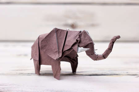 Elephant 3D origami model. Accurate and detailed figurine made with wet-folding technique. Talented childs artwork.