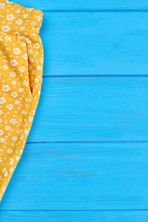 Cropped image of infant girl pants. Baby girls yellow summer pocket trousers and blank copy space. Stock Photo
