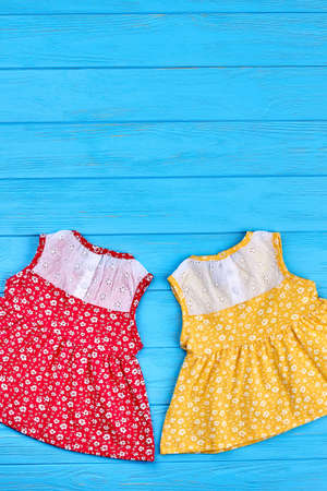 Top view of beautiful baby vintage dresses. Summer cute baby girls sundresses and copy space. Little girls summer fashion retro style.