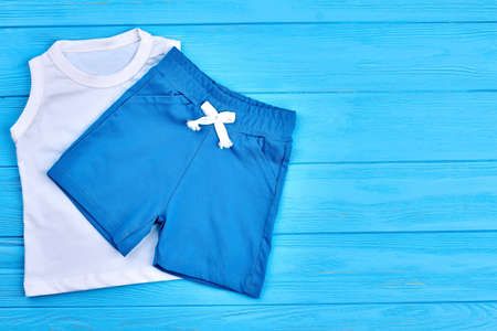 Baby boy shorts and t-shirt. Little boy summer apparel and copy space. Infant kids cotton garment.