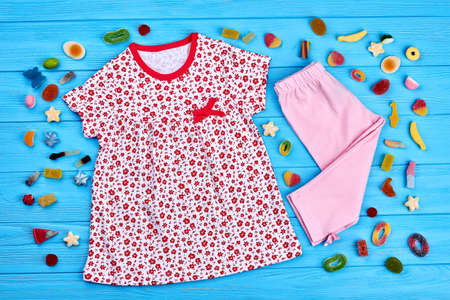 Baby-girl summer fashion background. Toddler girl high quality summer apparel on sale. Infant baby natural cotton clothing.