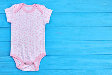 Cute natural bodysuit for girl. Fashion design cotton romper for toddler girl and copy space. Baby-girl brand clothing on sale.