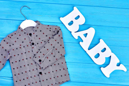 Fashion grey baby-boy cotton shirt. Collection of new apparel for baby-boy. Little boys modern clothes.