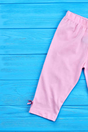 Cropped image of baby-girl cotton capri. Natural cotton breeches for toddler girl, top view. Stock Photo