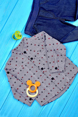 ee2854cd5 #90220958 - Top view of baby-boy fashion outfit. Infant boy new trendy  garment and accessories on blue wooden background. Kids fashion clothes on  sale.