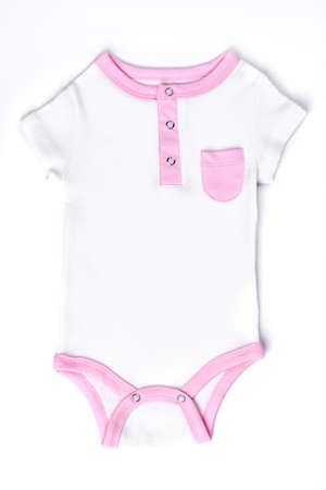 Infant girls organic cotton bodysuit. White and pink summer cotton romper for newborn girls, isolated on white background. Stock Photo