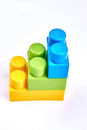 Plastic construction element of the children. Childrens plastic colorful constructor isolated on white background.