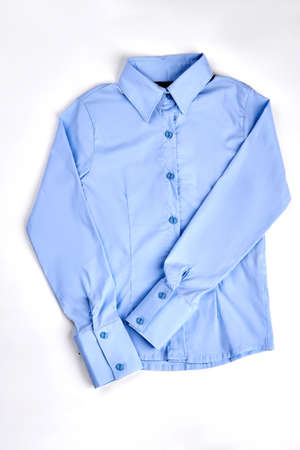 New high quality woman shirt. Girls luxury light blue buttoned blouse isolated over white. Casual formal women outfit on sale.