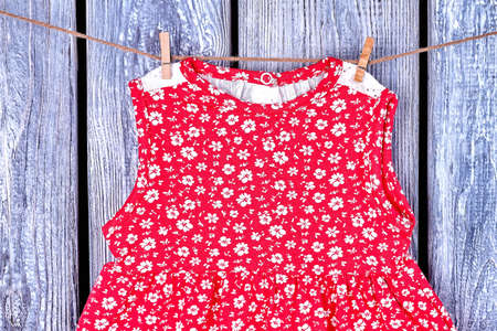 Infant Girl Sundress On Rope Baby Girl Casual Patterned Dress Drying On Clothesline On