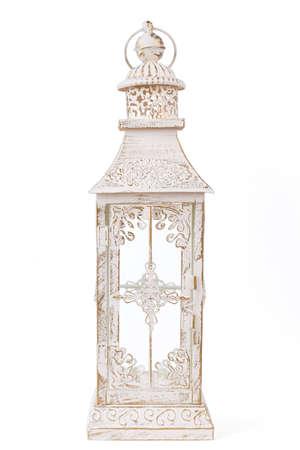 Candle lantern on white background. Isolated white lantern. Decorative candle holder.