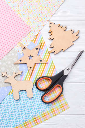 carved wooden christmas ornaments scissors patterned paper sheets scissors cut out christmas - Cut Out Christmas Decorations