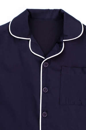 Close up on blue shirt. Rounded edges of collar, decorated with white stripe. Buttons and breast-pocket. Stock Photo