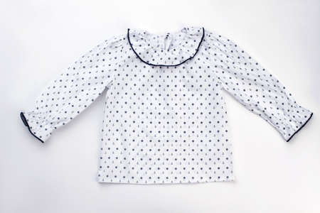 Cute pajama top on white background. Ruffle cuffs and collar, sailor pattern fabric. Kids sleepwear and robes. 스톡 콘텐츠