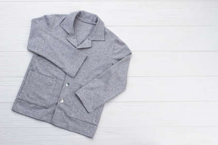 Gray shirt on white background. Pajama top with pockets. Men and boys clothing store.